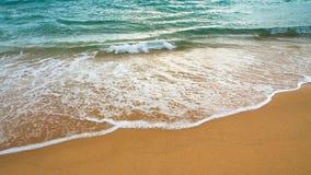 Det strandsanden och havet bevattnar Fotografering för Bildbyråer