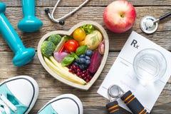 Det sunda livsstilbegreppet med bantar kondition och medicin arkivfoto