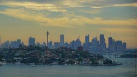Det Sydney centret i solnedgångtiden arkivfoton