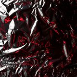 Det tunna arket av försilvrar bladbakgrund med skinande ojämn yttersida arkivbild