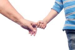 det vuxna barnet hands två Arkivbild