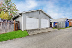 Detached double doors garage in the back yard Royalty Free Stock Photos