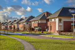 Detached family houses in a suburban street Royalty Free Stock Photos