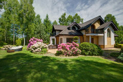 Detached house with beauty garden Royalty Free Stock Image