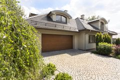 Detached house exterior with cobblestone driveway Stock Photos