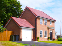 Detached house with garage UK. New modern build family home with garage UK Stock Photo