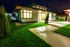 Detached house at night - view from outside the rear courtyard. Royalty Free Stock Photo