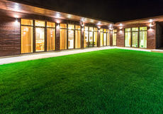 Detached house at night view from outside the rear courtyard. Royalty Free Stock Photos