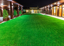 Detached house at night  view from outside the rear courtyard. Stock Images