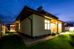 Detached luxury house at night - view from outside. Royalty Free Stock Photography