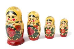 Detachment. Russian traditional wooden doll. White background. Two light source Stock Photos