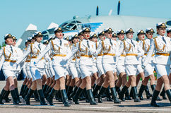 Detachment of girls` soldiers in a beautiful white uniform at the airport. Russia, Saint-Petersburg, June 2017. Stock Photo