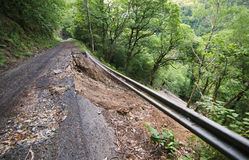 Detachment of the hillside which affects a rural road Stock Photos