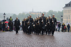 A detachment of the Royal guards marching on the square near the Royal Palace. Stockholm Stock Photography