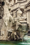 Detail of the. Fountain of the Four Rivers by Bernini, showing the Rio della Plata, Piazza Navona, Rome, Italy Stock Images
