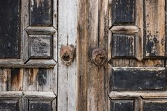 Detail of a abadoned door with arab ornaments at Emir Bachir Chahabi Palace Beit ed-Dine in mount Lebanon Middle east, Lebanon. Detail of a abandoned wooden door Stock Photos