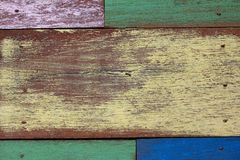 Detail of abstract art color wood wall. Yellow green blue purple stock images