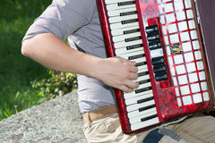 Detail of accordion player. Detail of who plays the accordion in the street outdoors Royalty Free Stock Photo