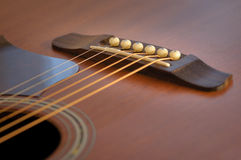 Detail of the acoustic guitar Stock Images