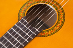 Detail of acoustic guitar Stock Images
