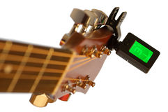 Detail of acoustic guitar with guitar clip tuner Royalty Free Stock Photos