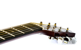 Detail of acoustic guitar with shallow depth of field on white background Royalty Free Stock Photography