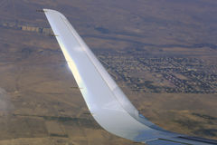Detail of airplane wing in flight Royalty Free Stock Photography