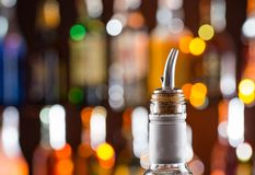 Detail of alcohol bottle with filler Stock Photography