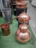 Brandy distillation boiler. Detail of alcohol distillation boiler in a store Royalty Free Stock Photos