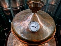 Brandy distillation boiler. Detail of alcohol distillation boiler in a store Stock Photography