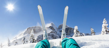Detail of alpine skier legs, watching the valley panorama Royalty Free Stock Photography