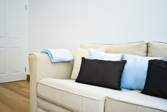Detail of an amazing beige sofa with cushions Royalty Free Stock Images