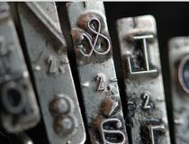 Detail of ampersand key in an old mechanical typewriter Royalty Free Stock Photo