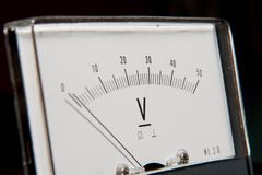 Detail of an analog voltmeter, pointer scale. Detail of an analog voltmeter, pointer and scale Royalty Free Stock Image