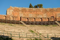 Greek Roman Theater in Taormina - Sicily Italy. Detail of the ancient Greek Roman theater at sunset in Taormina town, Messina, Sicily island, Italy II century AD Stock Images
