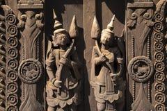 Ancient Shwe Inbin Monastery, in teak wood. Mandalay, Myanmar. Detail of the Ancient Monastery of Shwe Inbin, built with black teak wood and carved by hand stock photo