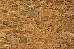 Detail of ancient moorish wall made of different sizes and shapes of stones. Detail of ancient wall made of different sizes and shapes of stones, detail of Royalty Free Stock Images