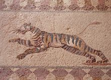 Detail of an ancient roman floor mosaic with the image of a hunting bear from the archeological ruins known as the house of. Detail of an ancient roman floor royalty free stock photography