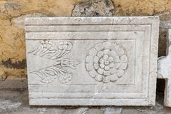 Detail of an ancient Roman marble sculpture in Bodrum. Detail of an ancient Roman marble sculpture or engraving in Bodrum Castle, Turkey royalty free stock photography