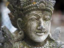 Stone statue of a goddess in a temple in Bali, Indonesia royalty free stock photography