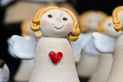 Detail of angel with red heart Royalty Free Stock Image