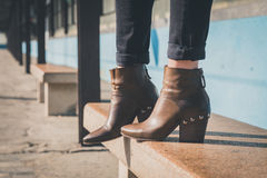 Detail of ankle boots in a metro station. Detail of ankle boots on bench in a metro station royalty free stock photos
