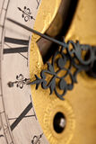 Detail of antique clock with Roman numeral. Macro lens stock images