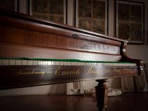 Detail of an antique Emerich Betsy piano constructed in 1854. These pianos were made with Burl Wood, each finished with hand craftsmanship inclusive of hand Stock Photo