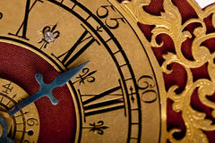 Detail of antique gold and red clock Royalty Free Stock Photography