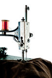 Detail of antique sewing machine, isolated Stock Photography