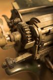 Detail of antique typewriter carriage. Detail view of antique typewriter carriage showing gears Royalty Free Stock Image