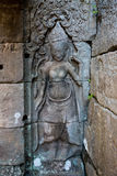 Detail of apsara dancers carved at the Angkor Wat complex in Cambodia. royalty free stock images