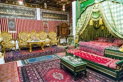 Detail of an Arab-style bedroom with bed and tea room Royalty Free Stock Image