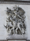 Detail of Arc de Triomphe de l'Etoile. One of most famous monuments in Paris. Arc de Triomphe (1836) was built by architect Jean Shalgrenom by order of Stock Photography